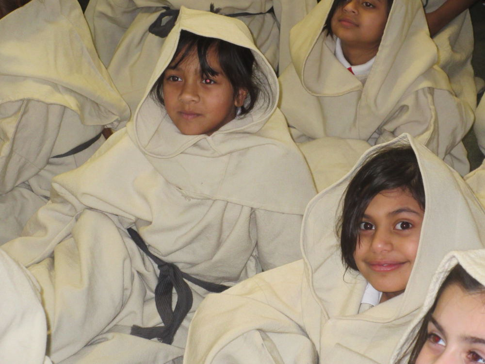 children dressed as monks