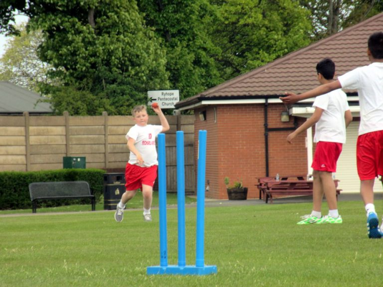 The Boys Year Six Cricket team playing a match