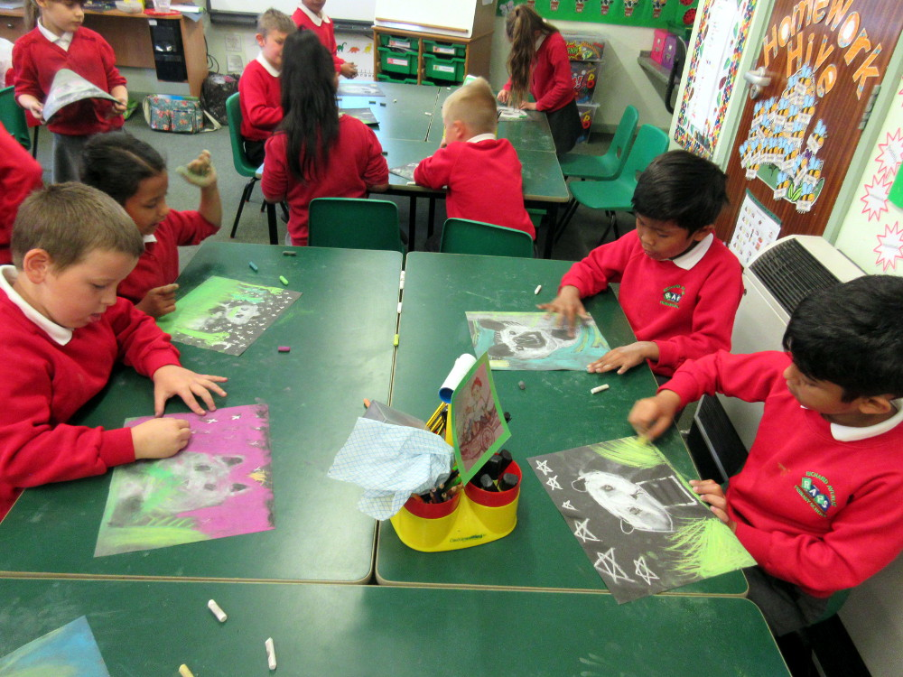 Year 2 children draw animals using chalks and pastels
