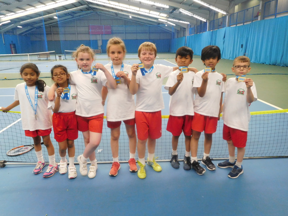 Year 3 with their gold medals for Tennis