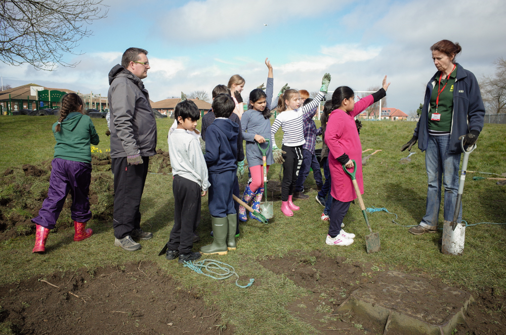 The children preparing the new Wildflower meadow