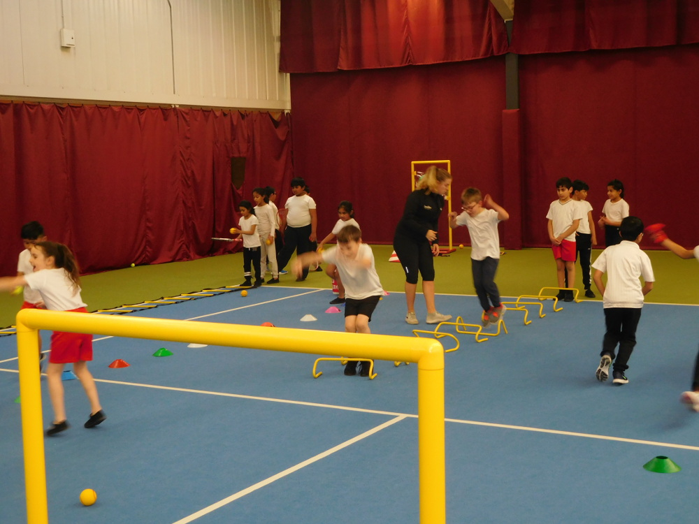 Year 3 get tennis coaching