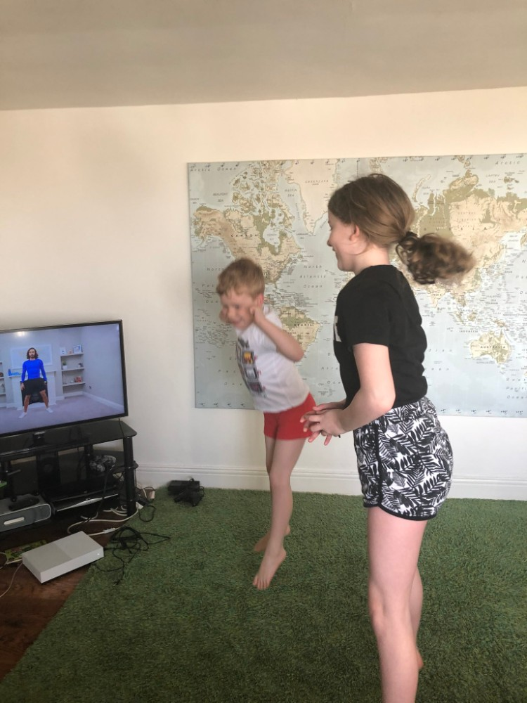 children exercising at home