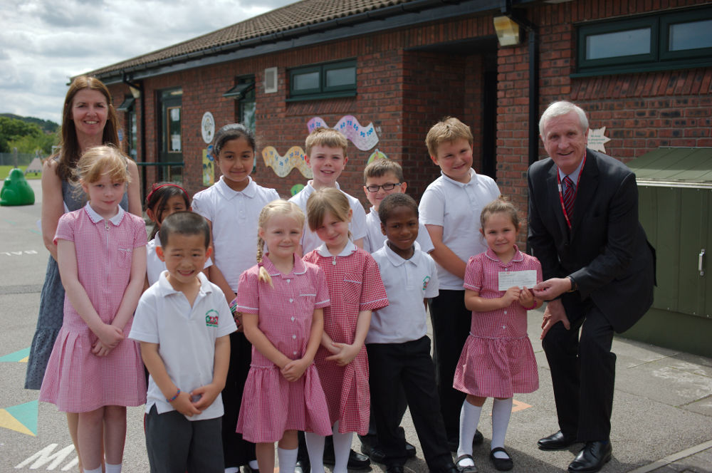 Children present Age UK with a cheque for £800