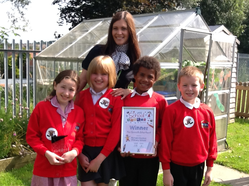 Miss Halliday with the winning students