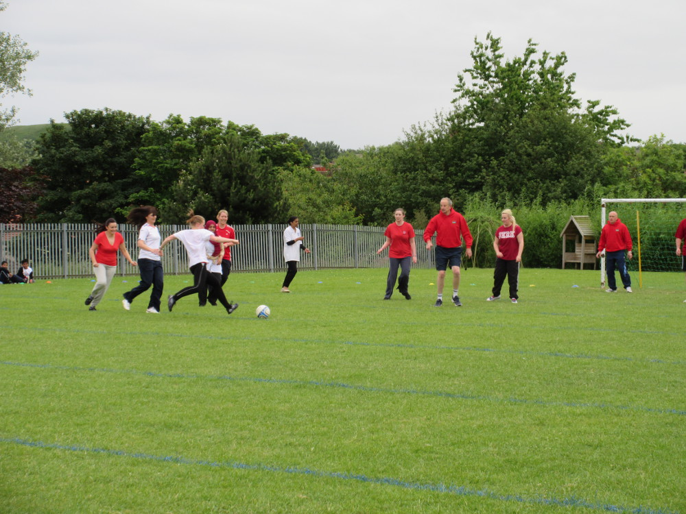 The staff battle it out on the school pitch
