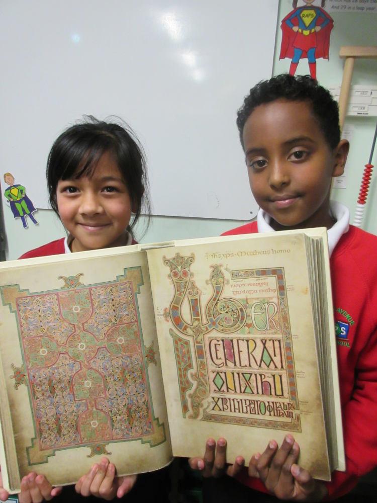 children with the Lindisfarne Gospels replica