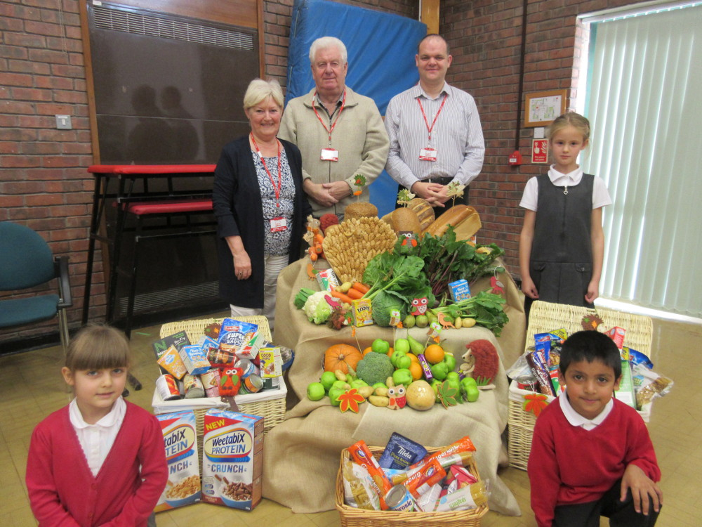 Children with their food bank donation