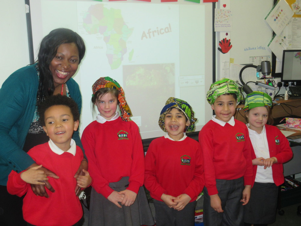 Year 1 with their parent visitor who comes from Africa