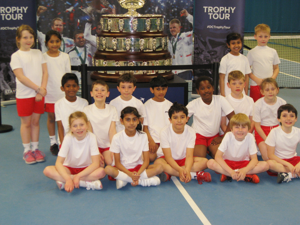 The tennis squad with the Davis cup