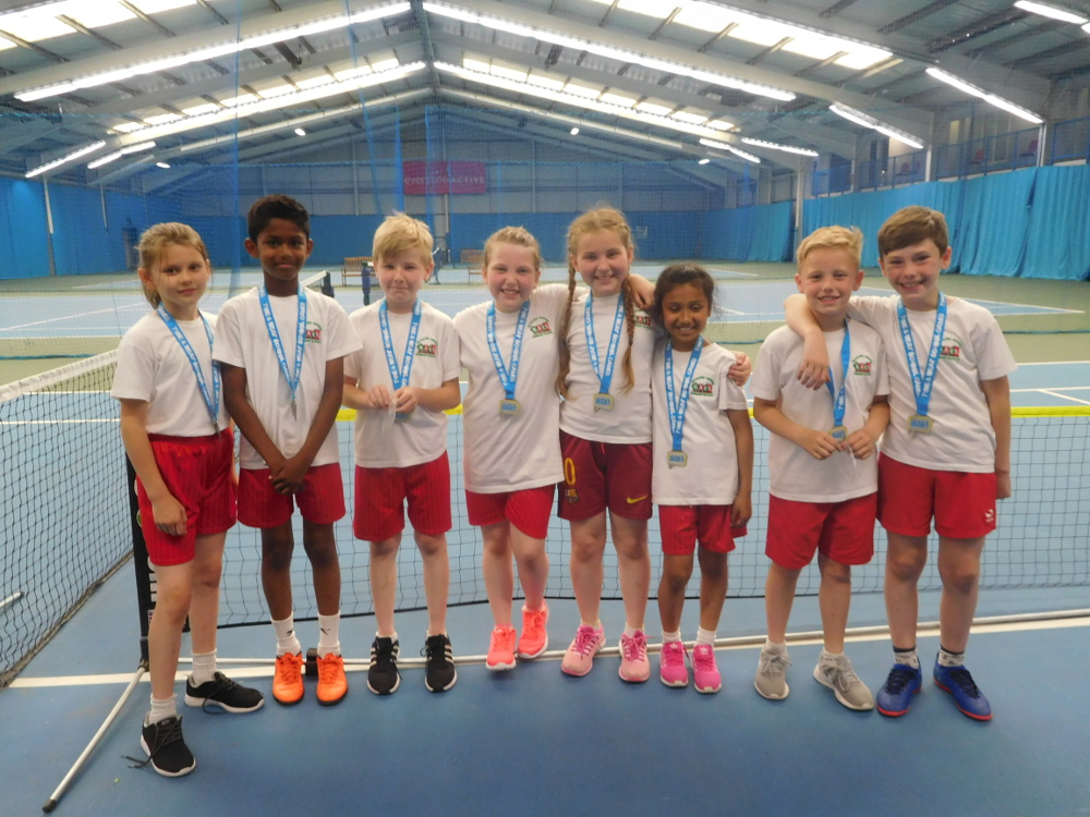 Year 4 with their silver medals for Tennis