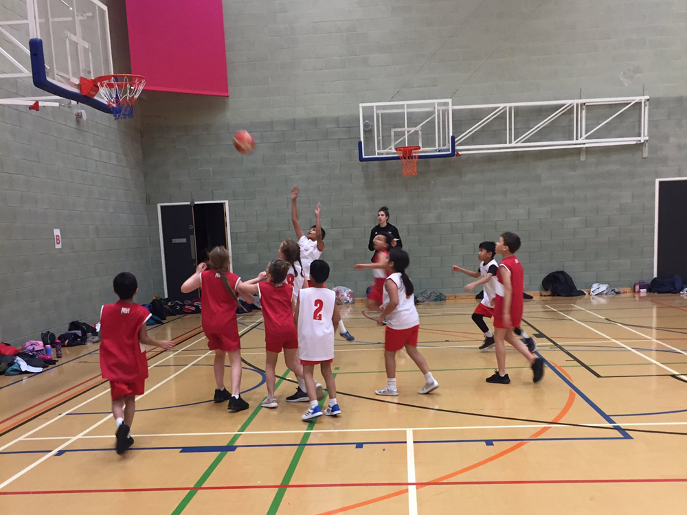 The Year 5 Basketball Teams in Action